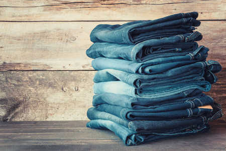 jeanswear: Stacked fashion blue jeans in store