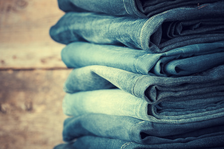 jeanswear: Stacked fashion jeans closeup. Retro toned.