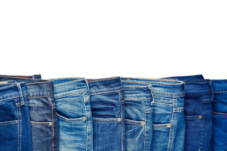 jeanswear: Row of fashion different jeans isolated on white background. Stock Photo