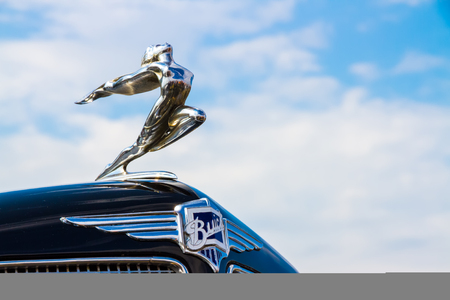 motor cars: Minsk, Belarus - May-5-2012: Logo of vintage Buick motor car close up at exhibition of retro cars in Minsk, Belarus.