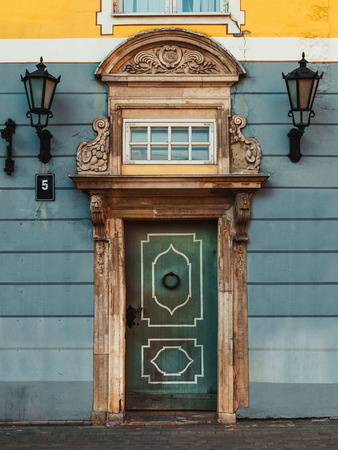 old building facade: Vintage door on a old building facade in old Riga city, Latvia Stock Photo