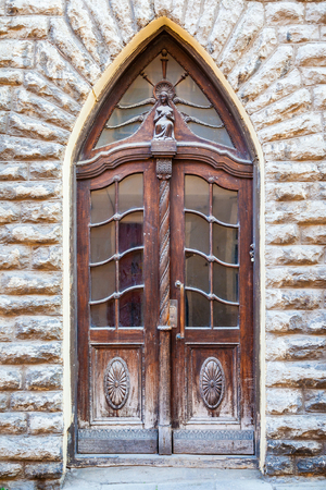 old building facade: Vintage door on a old building facade in old Tallinn city, Estonia Editorial