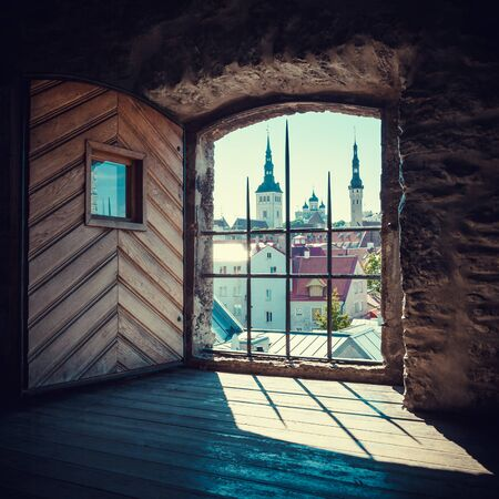 Retro styled View of old Tallinn city from the window of medieval tower