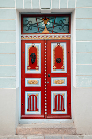 old building facade: Red vintage door on a old building facade in old Tallinn city, Estonia