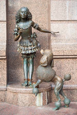 golden key: KIEV, UKRAINE - SEPTEMBER 23, 2016: sculpture of Malvina and Artemon dog, fairy tale characters of Alexei Tolstoy store The Golden Key near entrance to Kiev academic puppet theater in Kiev, Ukraine.