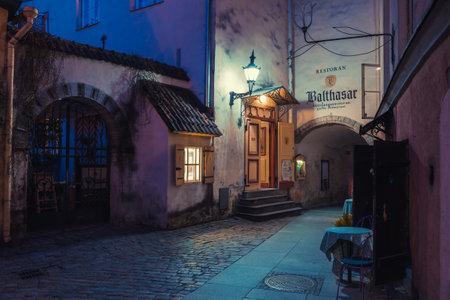 balthasar: Tallinn, Estonia - June 02, 2016: medieval street and restaurant Balthasar in the Historical Centre of Tallinn city at dusk. Tallinn, Estonia.