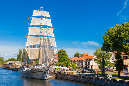 oldtown: LITHUANIA, KLAIPEDA - JULY 20, 2016: Restaurant on sailing boat on Dane river in oldtown of Klaipeda. Lithuania.