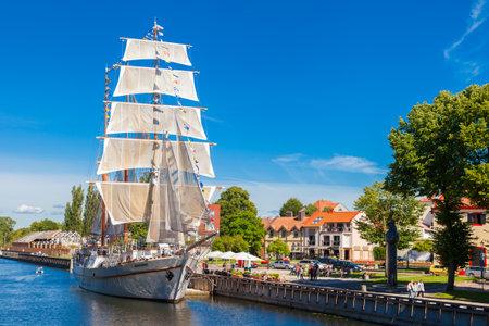 LITHUANIA, KLAIPEDA - JULY 20, 2016: Restaurant on sailing boat on Dane river in oldtown of Klaipeda. Lithuania.