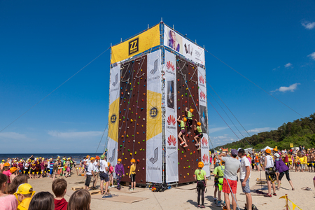 jurmala: Jurmala, Latvia - 28-May-2016: children climbing competition at ZZ festival, celebrating of opening of the summer holiday season in Jurmala, Latvia.