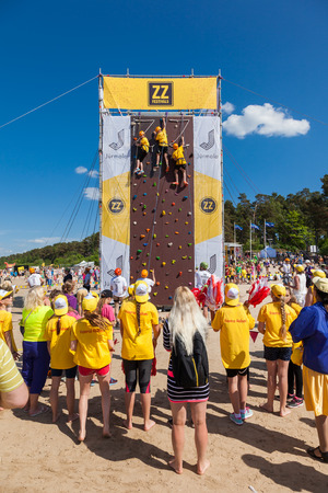 jurmala: Jurmala, Latvia - 28-May-2016: children climbing competition at ZZ festival, celebrating of opening of summer season in Jurmala, Latvia.