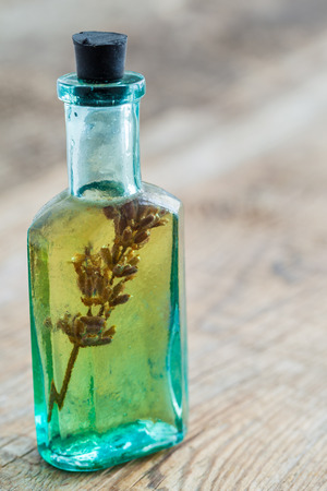 Vintage bottle of essential oil on table.