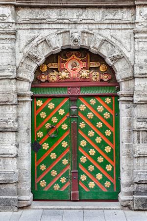 Vntage medieval door on a old building facade in old Tallinn city, Estonia