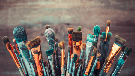oilpaint: Bunch of artistic paintbrushes. Retro toned photo.