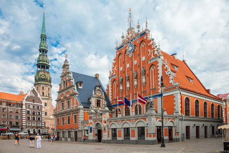 Riga, Latvia - 25-August-2015: Town Hall Square - house of the Blackheads and Saint Peters Church in old town of Riga, Latvia.