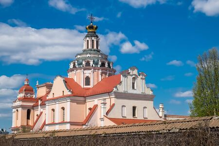 Roof and dome of St. Casimir Church with Golden crown of Jagiellons in old town of Vilnius, Lithuania. Stock Photo
