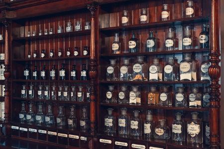 Kaunas, Lithuania - May 12, 2017: shelf of vials with retro drugs in old apothecary cabinet in Museum of the History of Medicine and Pharmacy. Kaunas, Lithuania. Stock fotó - 79289931