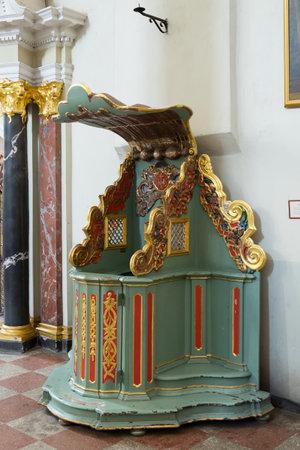 Vilnius, Lithuania - May 05, 2017: Retro wooden confessional inside St. Johns Church (Vilnius University ensemble), Vilnius, Lithuania.