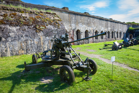 Brest, Belarus - May 12, 2015: The Fifth Fort of Brest Fortress in Belarus. Was built in 1878. Old guns in the foreground. Brest, Belarus. Editorial