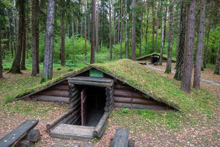 Stankovo village, Belarus - October 08, 2017: Entrance to the dugouton the territory of military historical complex Partizanen camp in Stankovo village, Dzerzhinsky District, Minsk Region, Belarus.