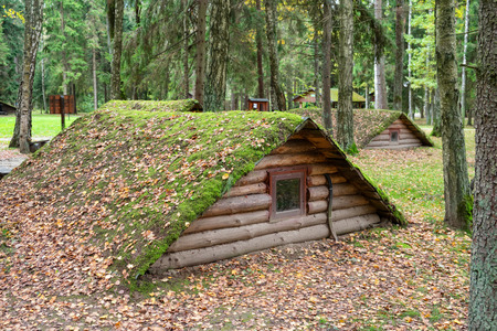 Stankovo village, Belarus - October 08, 2017: vintage wooden dugouts on the territory of military historical complex Partizanen camp in Stankovo, Minsk Region, Belarus. Editorial