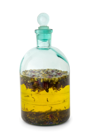 Herbal tincture or essential oil bottle on white.