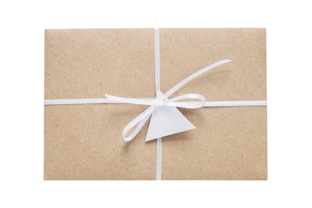 Envelope from craft paper decorated with ribbon and label. Isolated on white.