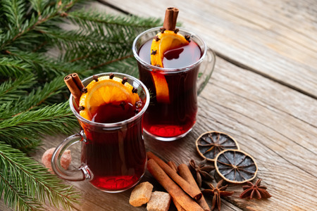 Glass mugs of mulled wine on wooden table. Copy space for text. Stock Photo