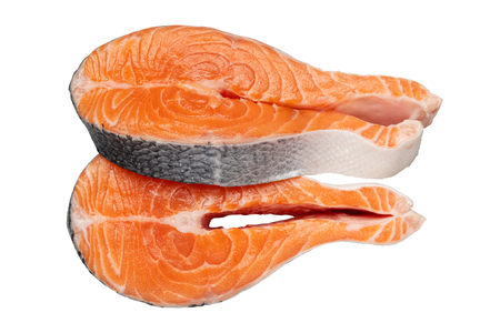 Two raw salmon fish steaks, isolated on white.