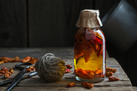Bottle of red chili pepper infusion or oil. Stock Photo