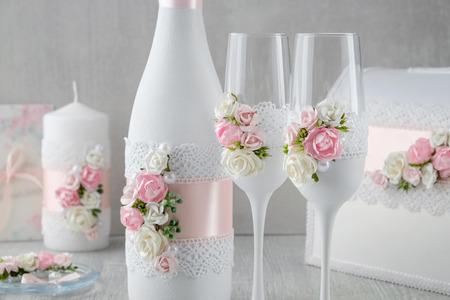 Wedding set: bottle of champagne, glasses, candle, wedding album, invitations. Stock Photo