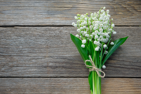 Lilies of the valley on wooden