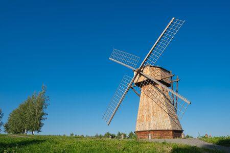 Beautiful ethnic Windmill on rural landscape.