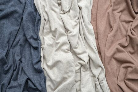 Knitted indigo, beige and brown fabrics, draped jersey cloths