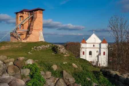 Ruins of Tower and Mindovg Castle on hill, Farnese Church of Transfiguration of the Lord in Novogrudok, Belarus.