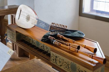 Mir, Belarus -  23-October-2019: musical instruments - viola da gamba, spinet, pipe, lute at exposition in Mir castle. Mir, Grodno region, Belarus.