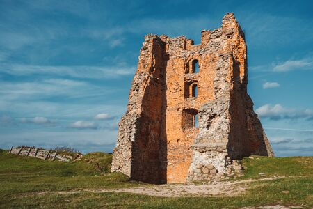 Ruins of Tower Shchitovka and Mindovg Castle on blue sky