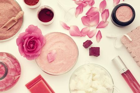 Homemade skin product with flower on white Фото со стока - 149923877