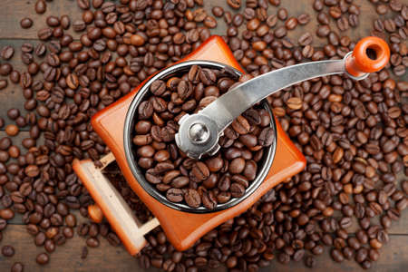 coffee grinder with coffee beans, top view Фото со стока