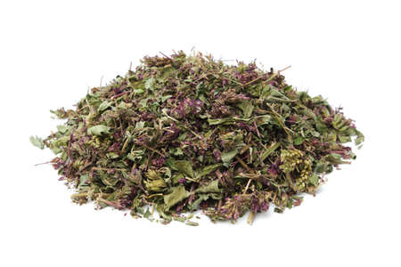 Pile of dry Origanum vulgare flowers. Dried wild marjoram heap on white. Alternative medicine.