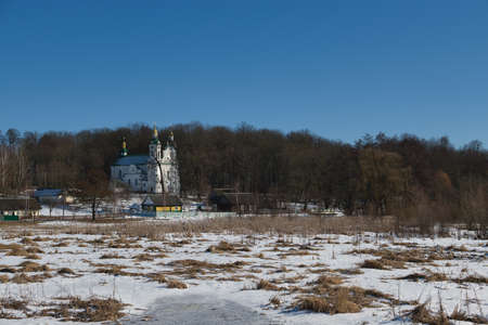 Ancient orthodox church of the Holy Trinity against a rural landscape, Volno village, Baranovichi district, Brest region, Belarus.