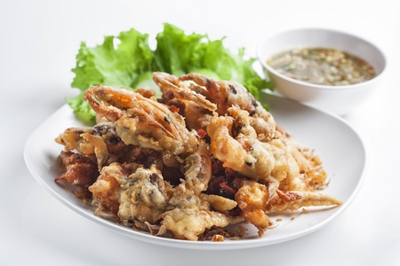 Batter-fried soft shell crab on white background  photo