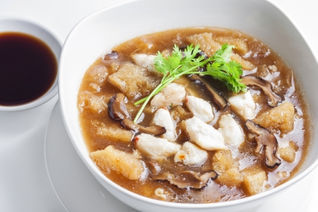 crabmeat: Braised Fish Maw in Red Gravy with crab in bowl  Stock Photo