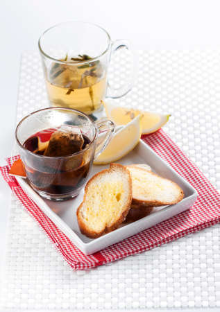 stimulated: Tea set against baguette with butter and sugar