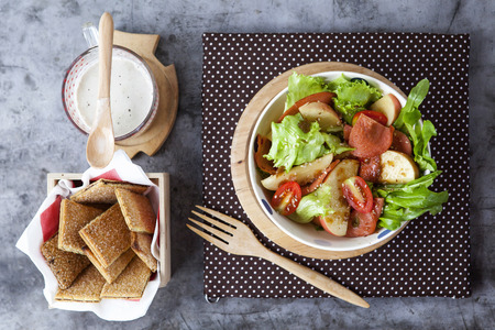 Bologna salad in bowl and cracker against soybean milk on cement Background  photo