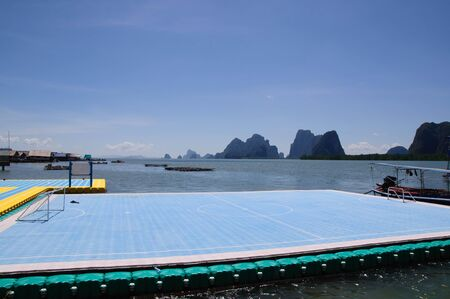 because of no land for playing football so a floating football ground is made for children in Panyee island - krabi, Thailand  photo