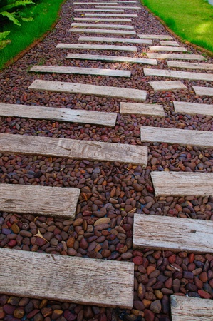 the footpath has paved a way by round rocks and woods Stock Photo - 16347134