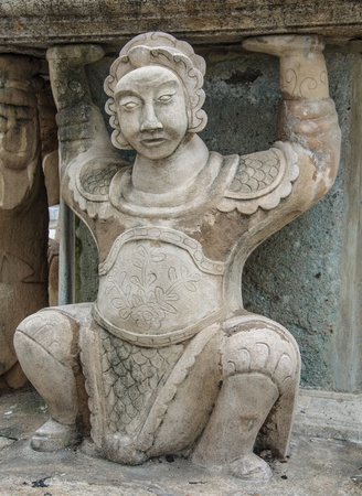 chinese sculpture in wat pho has its old more than 200 years. photo