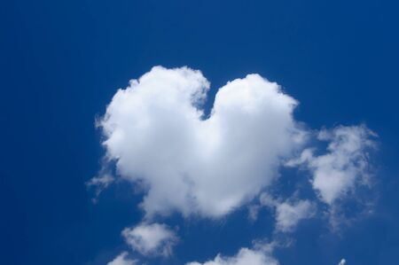 a soft white heart cloud on the blue sky photo