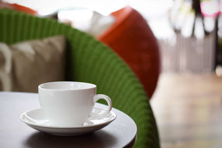 Coffee cup on table in cafe (vintage background) Stock Photo