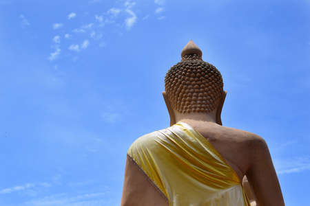 behind of buddha statue and blue sky(background)